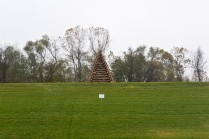 These bonfires-to-be are constructed all along the levees in Louisiana. (The Mississippi River is just on the far side of this levee, at those trees.) These bonfires guide Santa Claus to New Orleans and each community along the river builds their own in a unique shape.